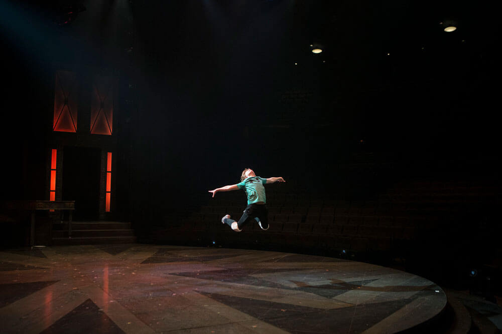 Nolan alone centrestage in arched jump